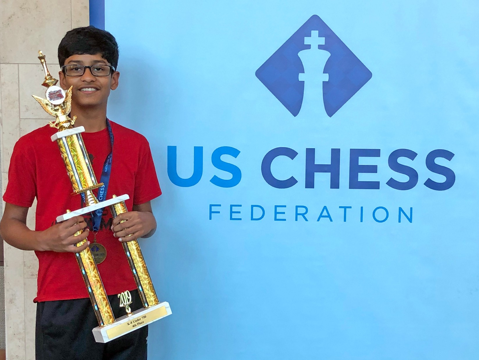 Two middle schoolers compete on grand stages