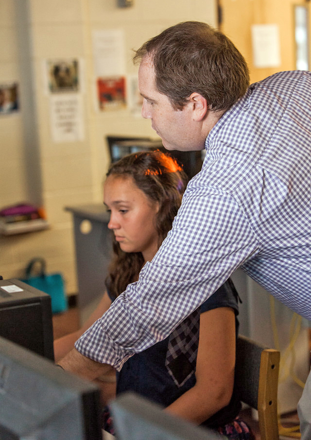 girl and teacher in computer lab